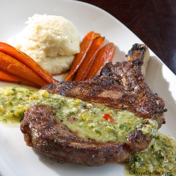 bistec a la parilla | 14 oz. ribeye, celery root puree, baby carrots, garlic-cilantro-asparagus mojo