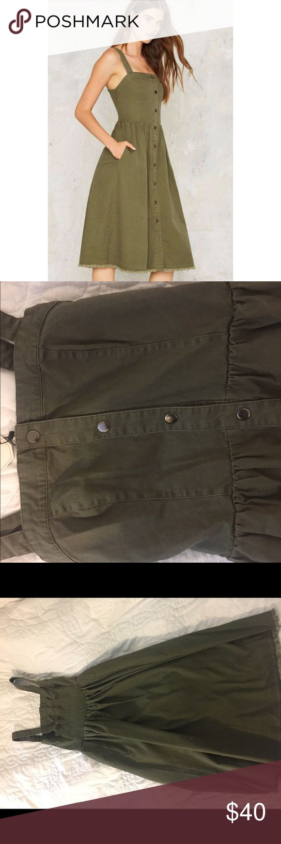Mo:Vint New York Rashida Denim Midi Dress NEVER WORN, WITH TAGS. Made of olive Denim with trendy full from gunmetal snaps. Elastic back and hits just below the knee. Looks good with sneakers, sandals or heels! Nasty Gal Dresses Midi