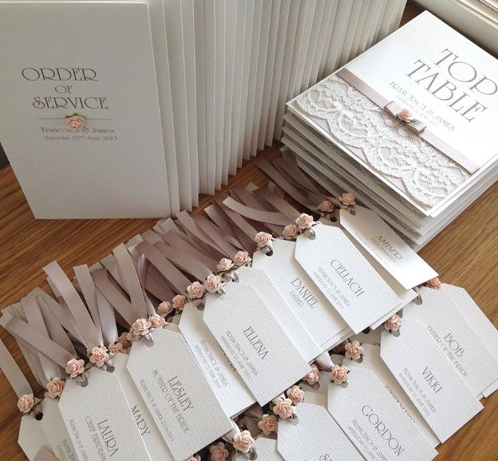 This is a cool wedding invitation idea: pin reception tags onto the invitation itself!
