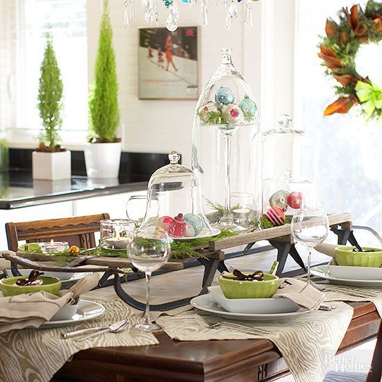 Elevate your centerpiece with a vintage sled. Top with an assortment of cloches, ornaments, and greenery to make it a fun DIY centerpiece for the holidays. After the holidays, keep the sled but replace the Christmas-theme accents with winter wares.