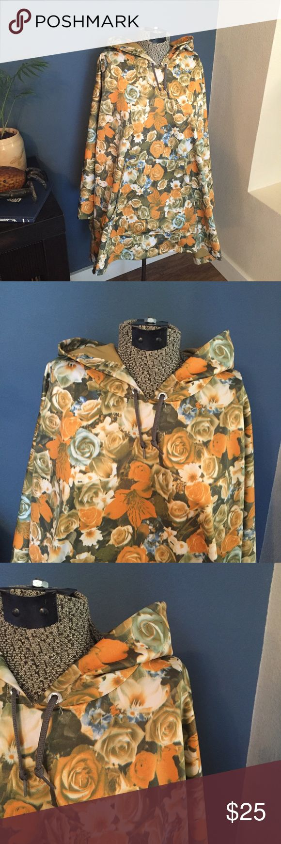 Floral poncho Real deal heavy duty poncho with front pocket. Perfect condition. Warm and water proof. Jackets & Coats Capes