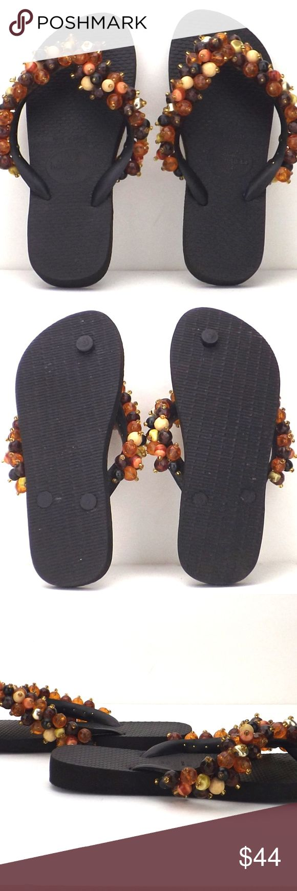 """womens beaded Havaianas Brazilian sandals thongs vintage Havaianas beaded Brazilian flip flops thongs zori sandals Hawaiian beach bohemian foot jewelry beach pool party rubber water resistant black foot bed round plastic beads orange black rust cream gold large beads topped with small glass beads securely wired through straps good vintage condition gently/rarely worn no detected issues tag size 35/36 Brazil 4.5 USA toe-heel l: 8 3/4"""" heel h: 3/4"""" toe h: 1/4"""" ball of foot w: 3 1/2"""" ball of…"""