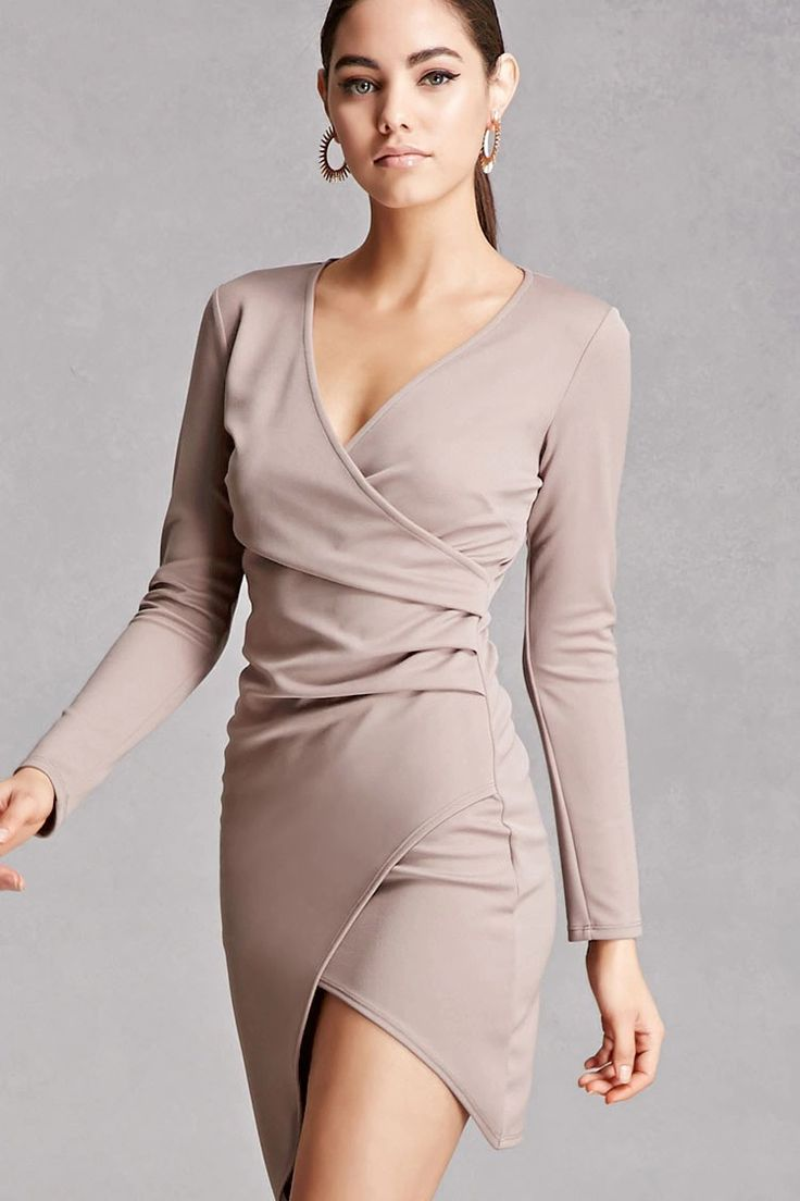 A knit mini dress featuring a surplice front, pleated sides, long sleeves, and an asymmetrical hem. This is an independent brand and not a Forever 21 branded item.