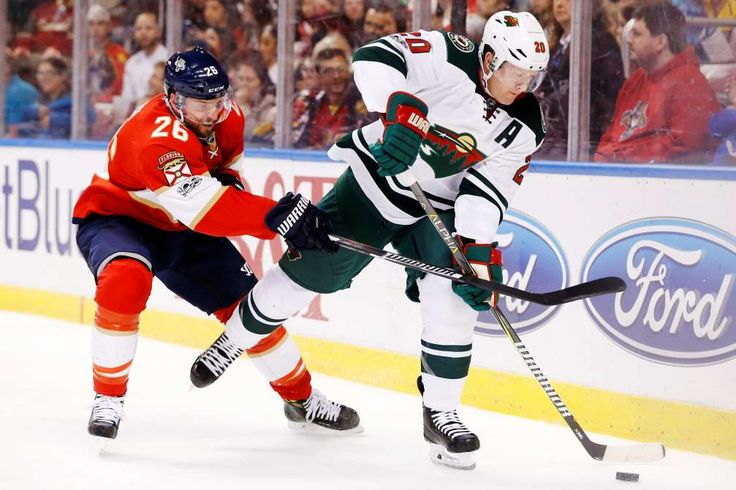 BATTLING FOR CONTROL:    Florida Panthers left wing Thomas Vanek (26) and Minnesota Wild defenseman Ryan Suter battle for the puck during the second period of an NHL hockey game, on March 10, in Sunrise, Fla.