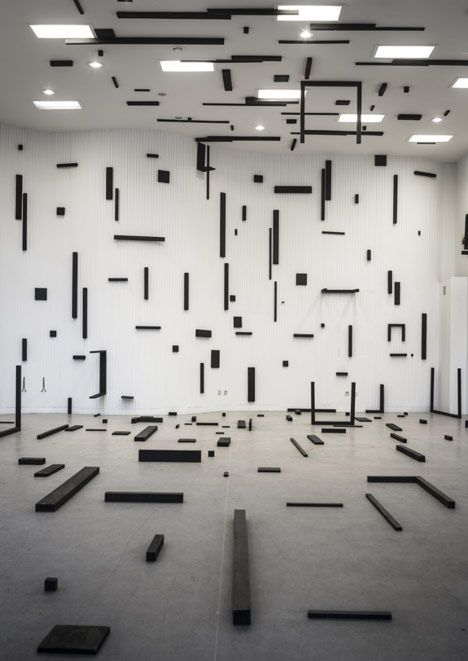 Artist Esther Stocker has built a disjointed grid of black blocks across the floor, walls and ceiling of Z33 – House for Contemporary Art in Hasselt, Belgium.