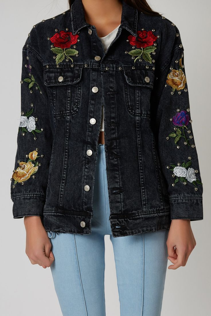 Studded denim jacket with flower patches throughout. Classic collar and front button up closure.