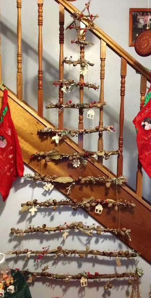 This is our home made Xmas tree I  made out of sticks , string , gum nuts and leaves and a few artificial berries
