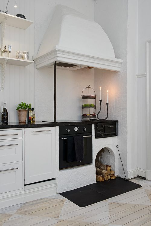 so scandinavian. love the wood burning stove. fabulous. just lovely. the simple things:)