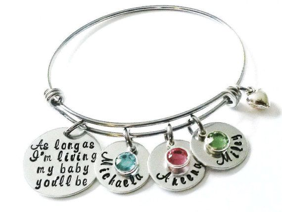 As Long As Im Living My Baby Youll Be Bracelet makes the perfect Mothers Day Gift for any Mother or Grandmother. This adjustable bangle bracelet is designed to be worn individually or stacked with other bangle bracelets. One size fits all. Bracelet is made of stainless steel.  Silver aluminum disc is hand stamped with the saying As long as Im living my baby youll be....and comes with 1 silver name disc and a genuine Swarovski birthstone crystal of your choice birth month. You can add…