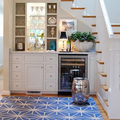15 Clever Uses For The Space Under Stairs