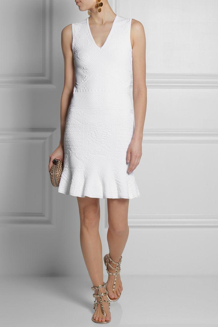Roberto Cavalli dress, Kenneth Jay Lane earrings, Valentino shoes, Bottega Veneta clutch.