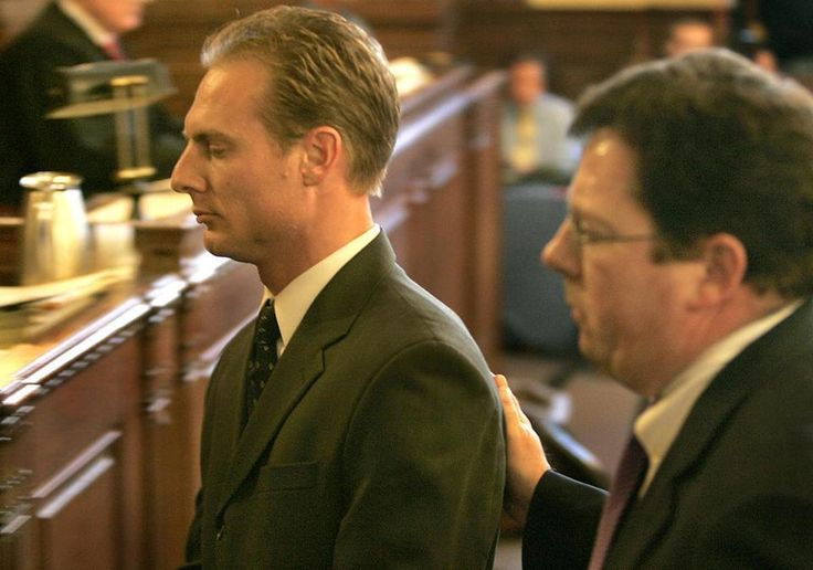 Daniel Biechele (L) leaves the Providence Superior Courtroom accompanied by his lead attorney Thomas G. Briody (R) after pleading guilty to 100 counts of misdemeaner manslaughter in the Station nightclub fire. Biechele was sentenced to four years in prison in 2006 and was released in 2009.