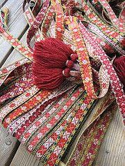 Bunch of red ribbons, 2010 (yarn jungle) Tags: badge bunad bnd forklebnd bndvev
