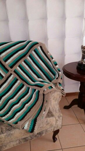 Crocheted green striped squates and another blanket is born