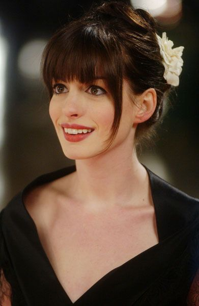 Obsessed with Anne Hathaway's hair in The Devil Wears Prada. I want those bangs!