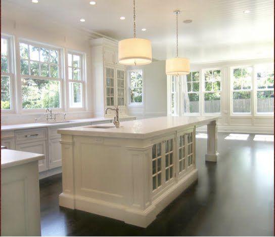 Classic white kitchen + dark floors