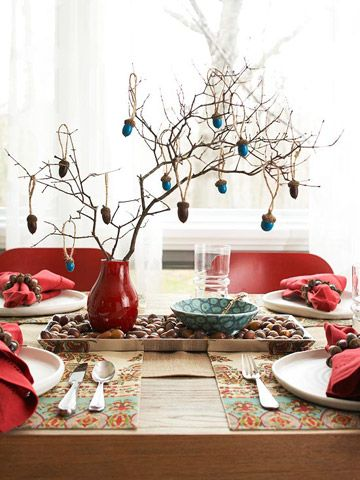 """Vase with branches and acorn """"ornaments"""" via Better Homes and Gardens."""