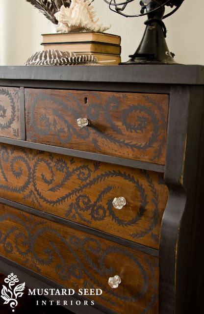 Miss Mustard Seed left the drawers wood, painted the body black and added a little decorative painting to the front.