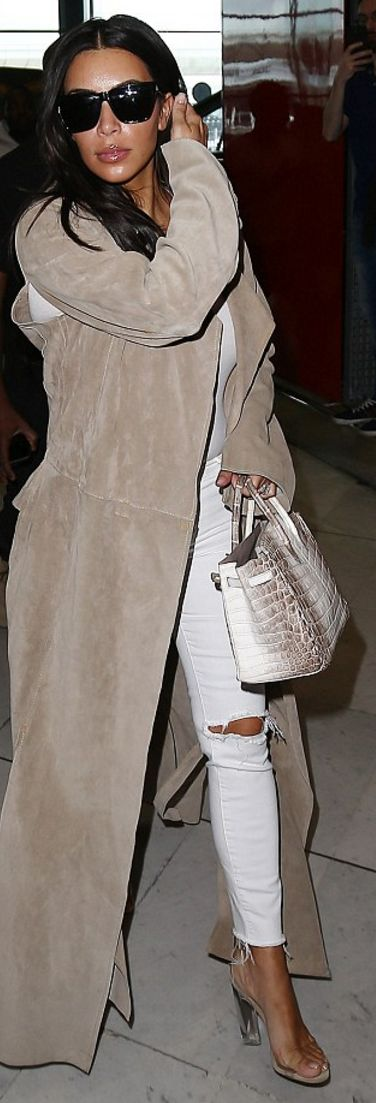 Who made Kim Kardashian's white ripped jeans, clear sandals, white top, tan handbag, and black sunglasses?