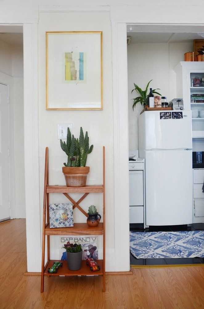 A young couple transforms an Oakland, California rental apartment into a cozy home with thrifted treasures.