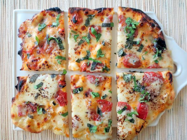 Margherita Pizzas on the Grill- Great way to use all of your fresh, summer tomatoes.  Perfect, thin crust pizza dough that is so easy to make!