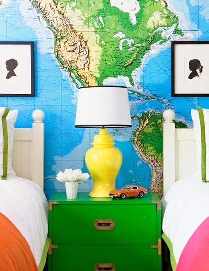 map wall, bright nightstand and accessories in shared kids room