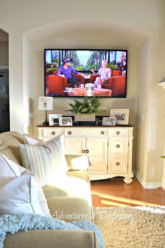 "Painted buffet or dresser as media cabinet under tv in a traditional ""tv nook"" via Adventures in Decorating: The Domino Effect:"