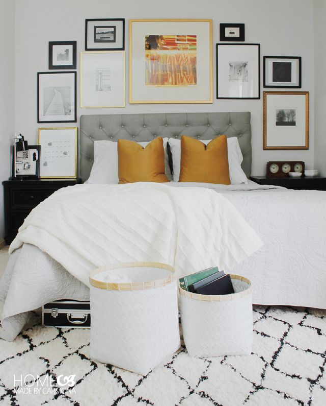Learn how to put together a chic bed surround gallery wall! It makes a stunning focal point in a room...