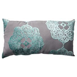 Pillow with a velvet-inspired medallion motif.   Product: PillowConstruction Material: 100% Polyester cover and polyester fiber fillColor: LagunaFeatures:  Flocked velvet textureSewn seam closureReverses to solid backInsert included Cleaning and Care: Spot clean only
