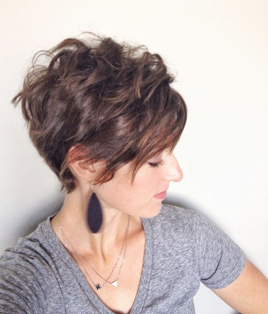 asymmetrical curly pixie cut with long bangs