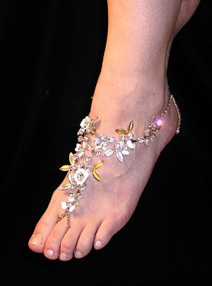 Something like this I think would be cute instead of heel that will hurt the puppies