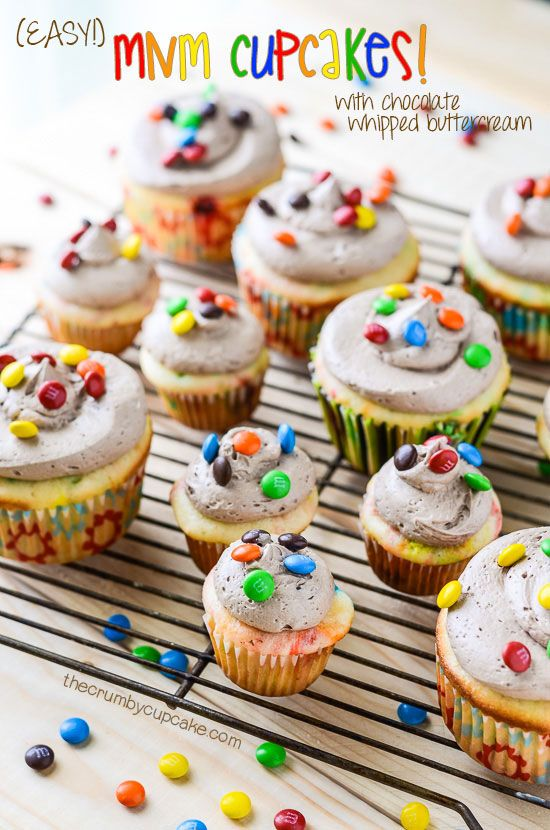Easy M&M Cupcakes | Start with a box cake mix, add a few extra ingredients, and these bright, fun, easy M&M Cupcakes will bring a smile to the faces of young and old alike!