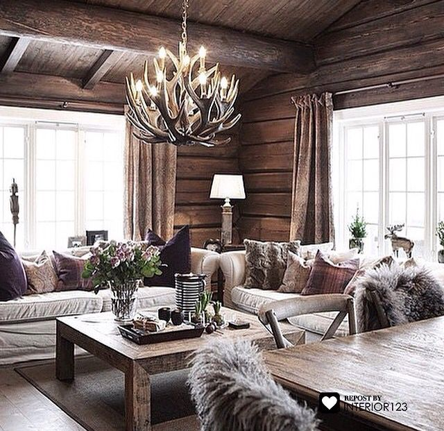 Modern rustic design, wood furnishings, rustic elements, area rug, upholstered seating, neutral colors, warm palette, cabin feel
