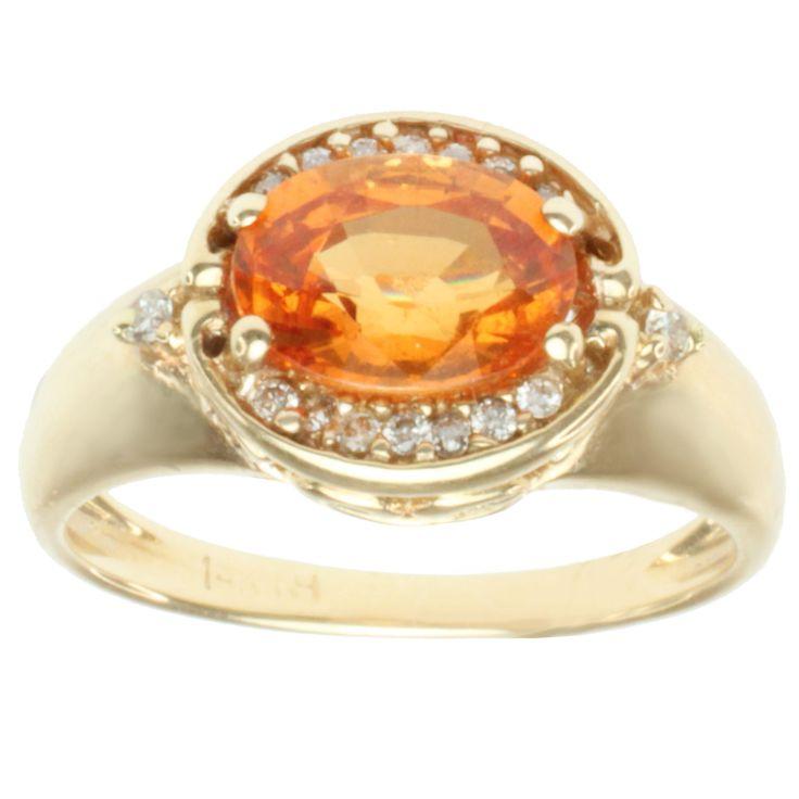 <li>Spessartite and diamond ring</li> <li>14-karat yellow gold jewelry</li> <li><a href='http://www.overstock.com/downloads/pdf/2010_RingSizing.pdf'><span class='links'>Click here for ring sizing guide</span></a> </li>