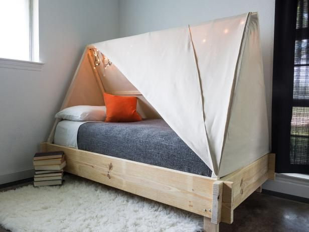 Inspire a spirit of adventure or just create a cozy hideaway for your kid with this adorable tent bed.