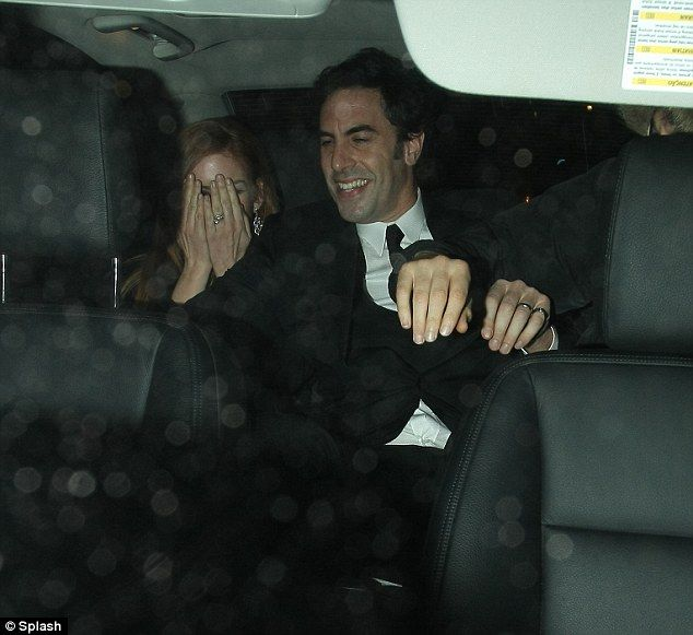 The hands?    She's still laughing! Sacha Baron Cohen and wife Isla Fisher go out after he makes Jimmy Savile joke branded by some as 'tasteless'