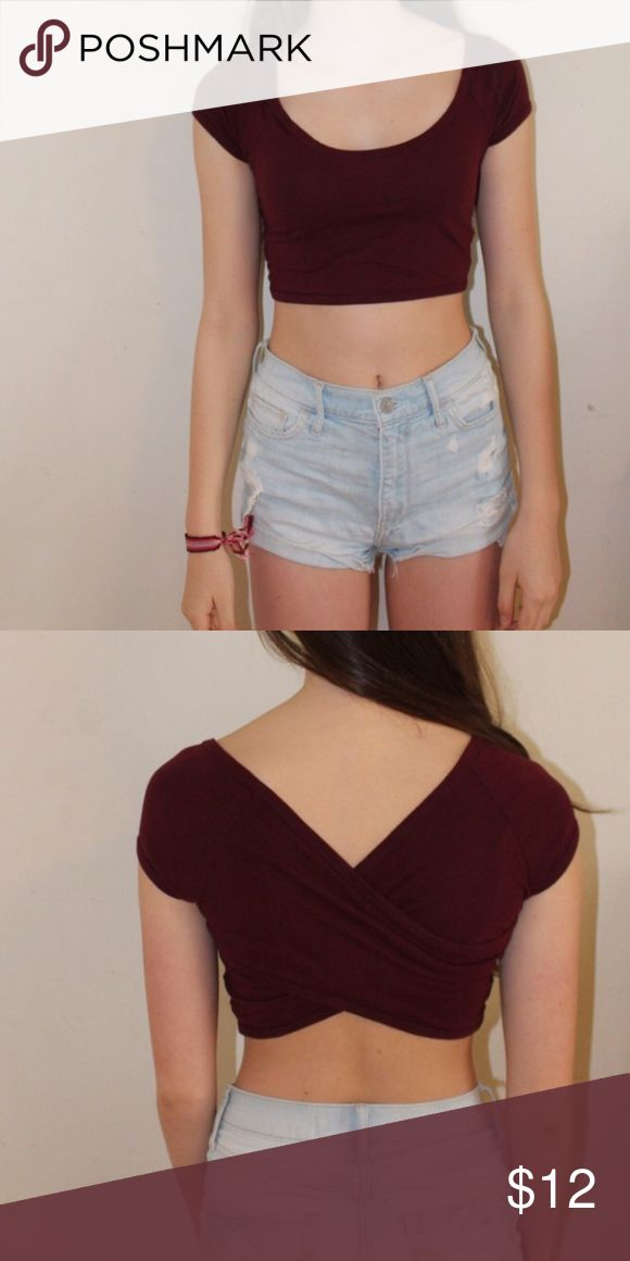 Burgundy Cross-Back Crop Top Deep red (burgundy) crop top / tshirt style sleeves and neckline / crosses in back / message me for any questions or concerns! / the price is always negotiable! :) Brandy Melville Tops Crop Tops