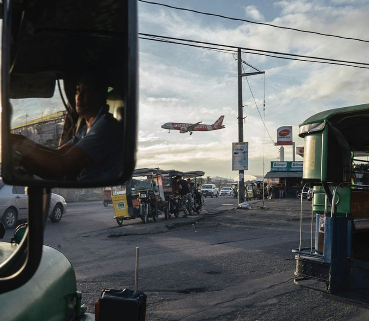 """Photo by @hannahreyesmorales. The morning commute, Manila. During the holiday season, millions of Filipinos reunited with loved ones as our diaspora came home to celebrate with family. In January, the balikbayans, our returning Filipinos, got on planes to go back abroad. """"My friends always say that going home to the Philippines is like pulling a thorn from your skin because you're finally coming home,"""" Bernardita Lopez, a returning domestic worker says. """"But when you have to leave again…"""