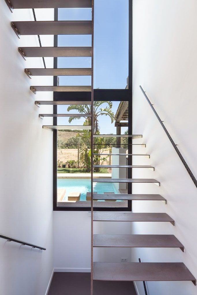 A House | 08023 Architects - Barcelona - Spain / View through the stairs. View to the swimming pool. #stairs #windows #landscape