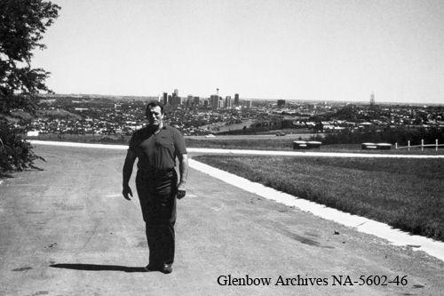 Title: Stu Hart on his property, Hart House, Calgary, Alberta. Date: [ca. 1965]