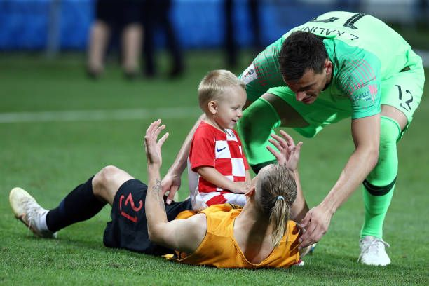 Domagoj Vida Of Croatia Celebrates With His Son Following