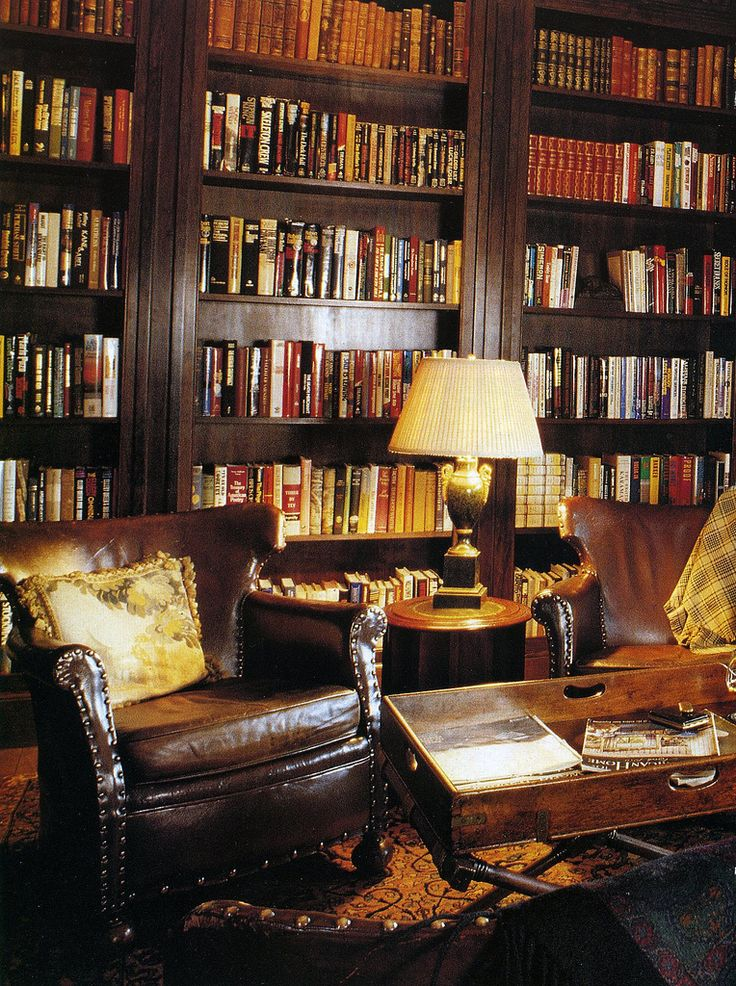my library will have high ceilings, dark wood furniture, forest green leather antique chairs, rolling ladder, and tall windows