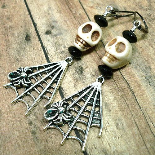 Get your scare on with these fun BOHO Halloween dangle earrings.  The skulls look like real bone but are actually a stone called howlite that has been finished to a rustic ivory color.  The darker brown etching lets the details of the eyes and spooky grin pop.  You will also see lines across the skull which reflects the look of aged cracked bone.  Above and below I used black agate saucer beads.  Swaying from the bottom of the ivory skulls are creepy spiderweb links with a crawly spider…