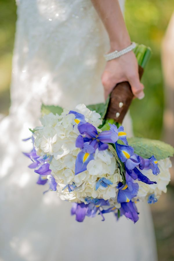 White Hydrangea Bouquet Peppered with Blue Irises| Summer Wedding at Hastings Lake Gardens|Photographer:  Barbara Rahal Photography