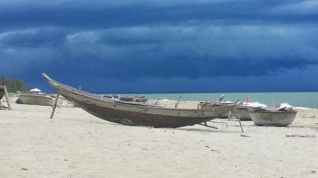 Boats at the beach of Boutique Hoi An resort.