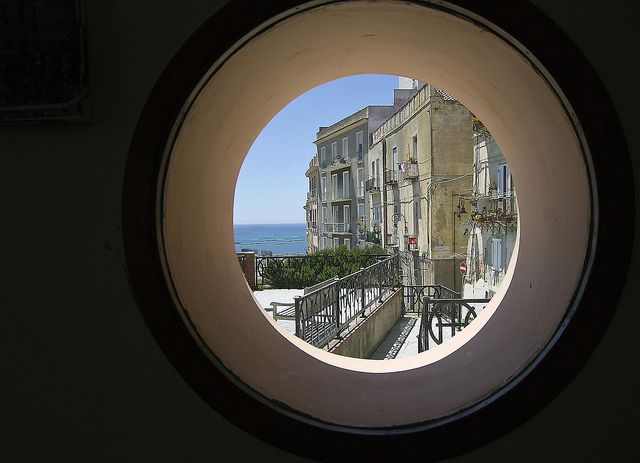 This little porthole window is in a small cafe in Cagliari - capitol of Sardinia - and looks out over the Castella part of the old town