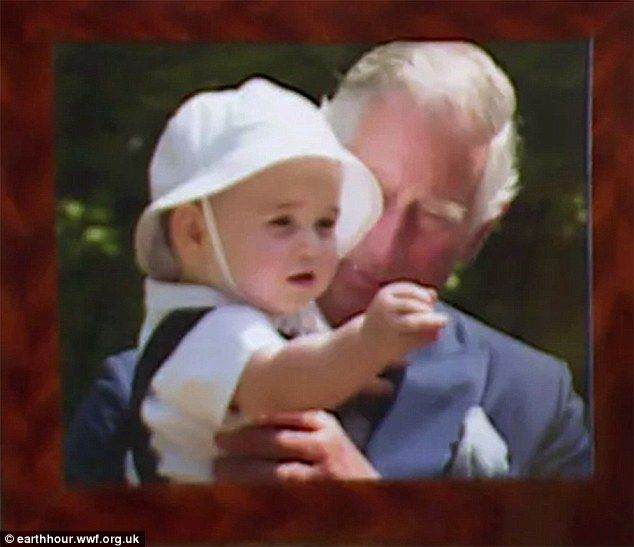 The photograph shows doting Prince Charles holding the young Prince, who looks as sweet as...