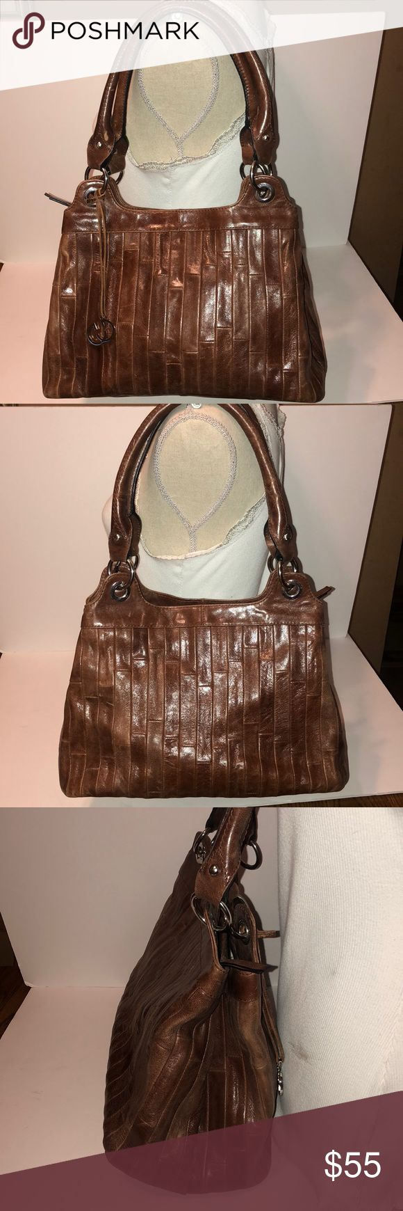 "Gerry Weber brown leather shoulder handbag This is a gently used Gerry Weber brown leather shoulder bag. Some light scuffs. It measures about 9"" x 13.5"" x6.5"". Lots of room. Two main compartments. One zips and one snaps. A zip pocket and two slip pockets inside. Thank you for looking! Gerry Weber Bags Shoulder Bags"