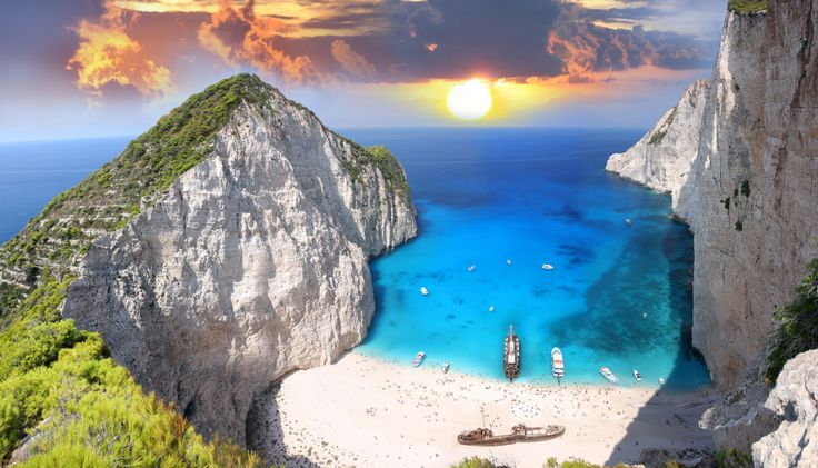 Shipwreck Bay (Navagio) Beach, Zakynthos: Who could have imagined that an old boat called Panayiotis would be the star of thousands of snapshots and videos that have pushed Zakynthos to fame the world over? The beach where it ran aground forms a magical setting with its sheer white cliffs, turquoise water and white sand. You'll be definitely tempted to dive right into its unbelievable clear water.