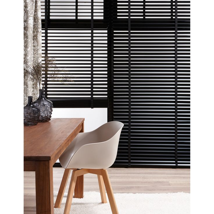 Black wood blinds with black tape